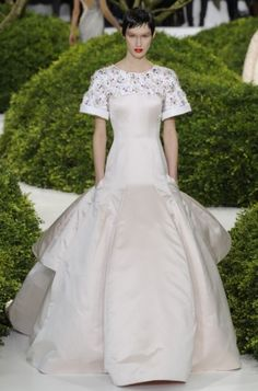 Christian Dior Spring 2013 Couture Collection - The new Christian Dior spring 2013 couture collection came as a breath of fresh air in the new season with fabulous fifties inspired dresses, floor-length gowns, floral applications and more. Check out the stunning collection!