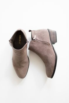 """Classic faux suede ankle booties Side zippers Small 2"""" back cut-out heel Lightly padded insole True to US size All man made material Imported"""