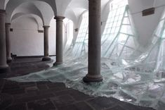 A Wall of Shattered Glass Floods a Benedictine Monastery water installation glass