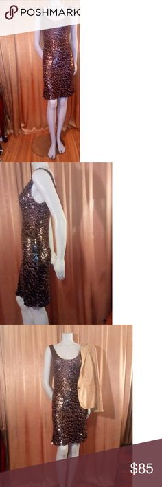 trina Turk sequin sheath strechy dress. Sexy sequin crotched dress. So comfortable and beautiful. Wear it with leather or dress it up with a Satin cocktail jacket. Fits 6 - 10. Trina Turk Dresses Midi