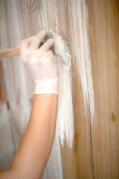 Going to try this with the paneling on my enclosed porch.  White washing panelled walls.  Bleach first with mix of bleach and water, white wash with half paint half water solution and wipe off.