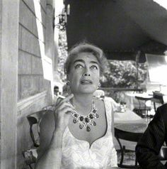 Joan Crawford dressed causally for an outdoor barbecue.