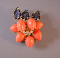 SCHREINER  orange cabochons brooch with carved leaf stones, unsigned  	Schreiner, 2-1/3 by 2. This lovely piece in other colors can be seen in  	the book Fabulous Fakes by Carole Tanenbaum on page 125 at the bottom  	right of the page where she also attributes it to Schreiner.