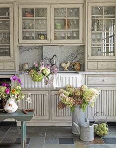 Fabulous Farmhouse Kitchens A trending style in natural elements ~ I love the whitewash cabinets, and lime green and pink color inspiration.