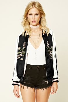 A reversible satin souvenir jacket featuring a floral embroidery, zipper front, slanted pockets, long striped sleeves, and ribbed trim. This is an independent brand and not a Forever 21 branded item.