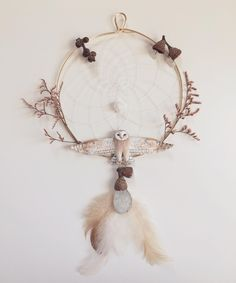 Here it is! I've had so much fun collaborating with @woodfauna (newly made shop account @wolphelia) to create this special one of a kind dream catcher. Chrissy from @woodfauna created this dream catcher from special woodland findings crystals and finished with a beautiful delicate weaving; paired up with my barn owl in flight. What do you think should I try out auctioning this piece here on Instagram?  by meadowandfawn