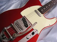 Fender Telecaster with Bigsby tremolo in candy apple red with binding and rosewood fretboard