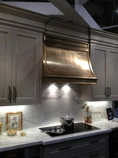 The hood is wood, it's a cold plating process using paint. This could work for a client who can't afford that hefty metal price tag. Kitchen Cabinet Design, Kitchen Redo, Home Decor Kitchen, New Kitchen, Home Kitchens, Kitchen Remodel, Kitchen Cabinets, Awesome Kitchen, Grey Cabinets