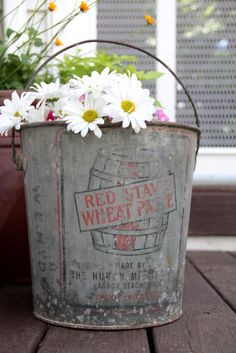 Industrial wedding ideas. Vintage Galvanized Metal Pail Bucket with Handle Rustic Industrial Advertisement Garden Decor. $22.00, via Etsy.