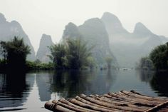 Rafting along the Li River in Yangshuo with a view of the breathtaking karst limestone peaks.