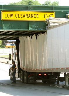 A semitrailer became stuck under the Brady Street railroad bridge at 5th Street in Davenport this morning, June 27, 2013. The trailer sustained major damage to its roof. (Larry Fisher, Quad-City Times