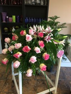 Stargazer lilies & pink roses casketspray by Donna Jeffries