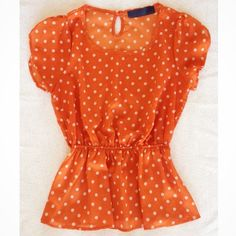 Flirty Orange and White Polka Dot Top Dress up your look with this flirty top, great for a weekend with denim shorts or office look with cropped slacks, has petal sleeves, keyhole detail on the back, elastic waist gives your body that perfect definition, about an inch of the thread along the elastic came undone and was carefully repaired (see fourth photo) Blue rain Tops Blouses
