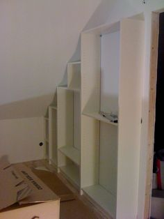 IKEA Hackers: Billy goes under the ceiling - this would be great in my under the stairs storage Basement Storage, Ikea Storage, Stair Storage, Ikea Billy Bookcase, Tv In Bedroom, Ikea Hackers, Butler Pantry, Under Stairs, Sloped Ceiling