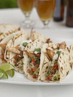 Easy, healthy, Fish taco recipe. Includes traditional cabbage slaw, pico de gallo and mexican crema.