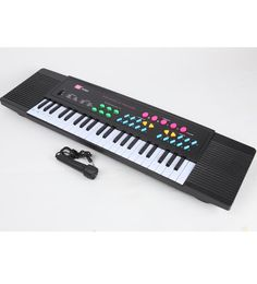 3738B Electronic Keyboard with Microphone  Assorted Colour – The color of some product parts may vary from what is shown in the image  Key Features of 3738B Electronic Keyboard with Microphone  37 Keys Keyboard Large Scale Integration Matrix Controlling Logical Circuit 8 Kind of Different Voices Control 32 kind of Speed Control 8 Kind of Rhythms 8 Kind of Tones 8 Famous Bollywood Demonstration Songs External Microphone DC / AC Power  3738B Electronic Keyboard with Microphone