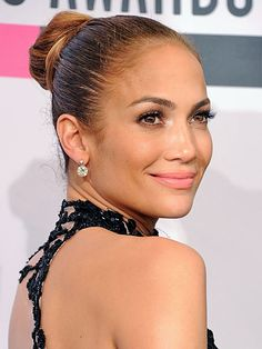 Jennifer Lopez's tight bun:  To get your hair even more out of your way, twist the tight ponytail into a bun and secure with three or four bobby pins. Add lipstick and sunglasses for a power diva look.