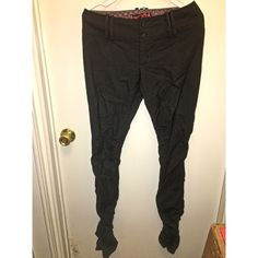 Free People Skinny Casual Pants This item is a pair of Free People skinny pants. These pants are composed of 70% Wool, 28% Rayon, 2% Spandex. So they do have a little extra stretch room in them due to the spandex. They are a casual fit, made to look like jeans but are not in fact jean material. The bottom of the legs have a bit of a ruffle like style on the leg when not worn. For anymore details please feel free to ask! This comes from a smoke-free home. Free People Pants