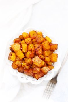 Simple Roasted Cinnamon Butternut Squash - This easy side-dish is as at home on your weeknight dinner table as it is a holiday feast. (Paleo and Vegan friendly!)