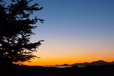 Sunset glow on a clear May evening looking out from Algy's garden towards the Small Isles - Muck, Rum and Canna - in the Inner Hebrides, Scotland. [Photo by Jenny Chapman.]