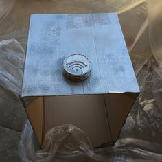 - Step 2) Add the wifi button on the side and the on button on the front. Then color the cardboard with metallic gray spray can.
