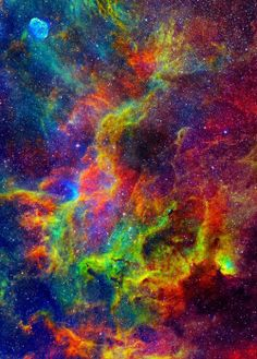 The Tulip Nebula  You know, I usually despise false-color images, mainly because they strip the image of reality, but this is just gorgeous.