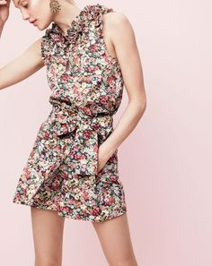 J.Crew women's Ruffle top and tie wait shorts in Liberty® Thorpe floral and beaded rumba earrings.