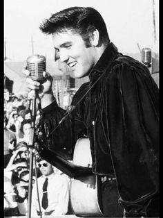 Elvis enjoying himself on stage.