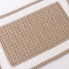 Crochet Rectangle Rug – (idk what this one is made out of yet, but you could make a door mat using twine, or thin rope.  A regular rug could be from strips of jean or other fabric, kitchen string, or yarn.