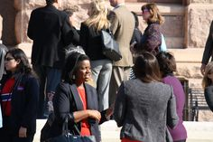 Kathryn Freeman (left), director of public policy at Texas Baptists' Christian Life Commission, visits with other attendees while waiting for a press conference on human trafficking to begin on the steps of the Texas Capitol on Thursday, Feb. 12, 2015.