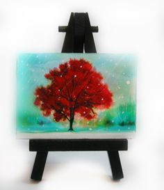 A personal favorite from my Etsy shop https://www.etsy.com/listing/465326694/winter-greets-autumn-aceo-original-easel