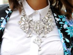 Three Cool Cats Blog:  http://www.shopthreecoolcats.com/blog/the-top-10-coolest-fashion-blogs-to-follow/    (Source: Thedailycandy)  #crystal  #statement  #necklace  #floral  #jacket  #white  #shirt  #fashion