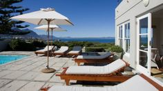 Ocean Eleven is an olde worlde, cape cod, colonial style guesthouse, with all encompassing sea-views of the bay, situated on the cliffs of Hermanus. Oceans 11, Wedding Function, Outdoor Furniture, Outdoor Decor, Cape Cod, Colonial, Deck, Patio, Guest Houses
