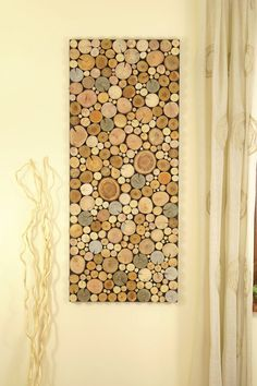 Environment wall art - tree rounds wall panel made of wooden slices of different species of tree. All slices are sanded for clear exposition of rings drawing. Beautiful and oryginal reclaimed wood art, perfect for environmentalists. To show a diversity of wood grain we use variuos tree