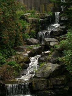 How to Set Up a Backyard Waterfall. Gorgeous.  For steep / sloping hills