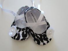 Black & White Leopard Baby Soft Ballerina Slippers. It has a white flower embellishment. This shoes are soft for those delicate baby or infant feet. The ribbon tie are long enough to wrap/tie around the ankle. #timelesstreasure