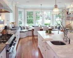 kitchen with bay window and built in seating, a 6-burner stove, Oh and two sinks! Yes