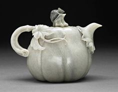 In the Chinese tradition, carved teapot