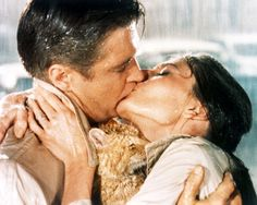 Paul Varjak played by George Peppard and Holly Golightly played by Audrey Hepburn kiss in a publicity still from 'Breakfast at Tiffany's' directed by...