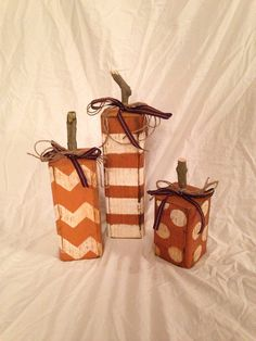 Hand painted 4x4 wood with stem and fall colored ribbons & twine. Great for your front porch or your mantle! Price listed is for one set of 3