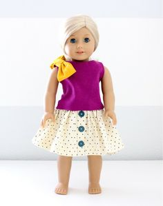 Cute fushia pink shirt with polka-dot Skirt and cute dandelion yellow bow on shoulder