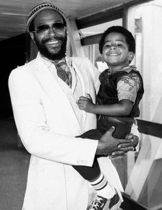 Marvin Gaye & his son. You can kind of see little man's Puma sneakers...