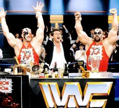 Vince McMahon with Hawk on his right, and Animal to his left, The Road Warriors/Legion of Doom.