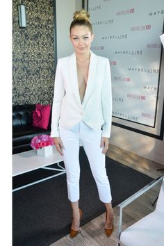 Who: Gigi Hadid What: A Sporty Summer Suit Why: The It model was sleek and sophisticated at a recent event in a fitted white pantsuit with cropped trousers and navy detail. Get the look now: Smythe pants, $495, singer22.com; Smythe jacket, $595, blacklabelboutique.com. - HarpersBAZAAR.com
