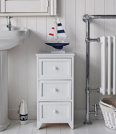 A Crisp White Freestanding Cottage Bathroom Storage Furniture A Narrow Bathroom Cabinet With 3 Drawers