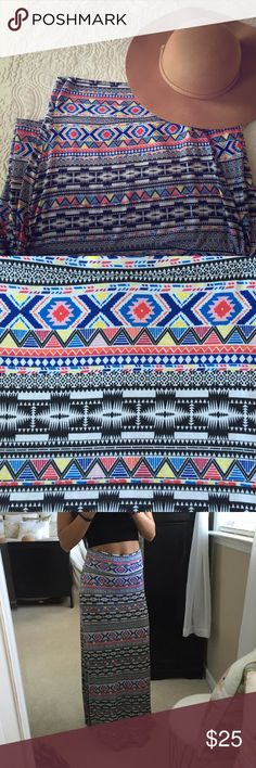 Charlotte Russe tribal maxi skirt Beautifully colored maxi skirt with side slits up to the knee. Pair it with a white or black crop or tee for a perfect casual outfit! In excellent condition Charlotte Russe Skirts Maxi