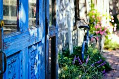 Ann Marie Ferrales Law captured this blue door and bike photo with a Canon EOS Rebel T2i and a Canon EF 50mm f/1.8 lens.