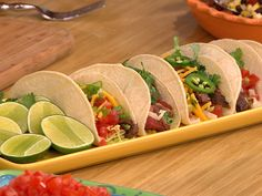 We're craving these grilled skirt steak tacos w roja salsa & charred corn salad!