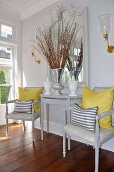 oomph pillows in grey and yellow create coziness in this pretty foyer setting