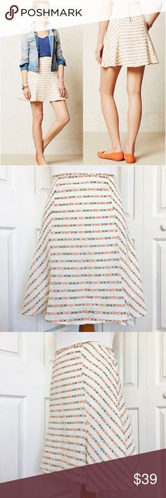 """Anthropologie Lucaya Swing Skirt by Maeve Anthropologie Lucaya shimmer textured swing skirt by a Maeve.  Features a subtitle shimmer and kicky silhouette.  Cream in color with multicolor neon stripes.  Zip up style in the back.  Shell of skirt is made 55% cotton and 45% polyester, lining is made of 100% polyester.  Measurement laid flat: waist 17"""", hip 21"""", and length 20"""". Anthropologie Skirts"""